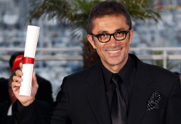 Director Nuri Bilge Ceylan poses during a photocall after receiving the Grand Prix award during the closing ceremony of the 64th Cannes Film Festival